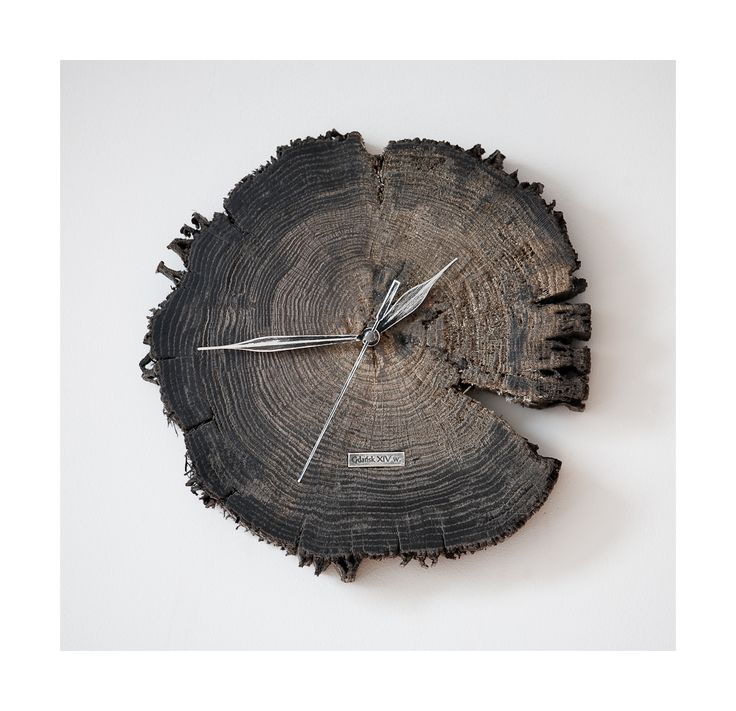 Model no 7. This clock is made of construction wood from the buildings of the Old Town of Gdansk. Black oak dating back to the 14th century. Size: 25 cm x 25 cm.