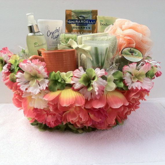 Luxury Spa Gift Basket. A cool and playful breeze blows into the glamour world, just in time for the summer to heat up with these playful colors, and with our one of a kind finest decorative design basket just for you with.  1 Spa Sock&Foot Lotion 1 Body Sponge 1 Candle 1 Cup 1 Body Spray 1 Crystal Light Lemonade 1 Lotion 1 Soap Rose Petals Ghirardelli Chocolate Squares Milk&Caramel rich chocolate,Luscuious Filling (This Item Is Sold)