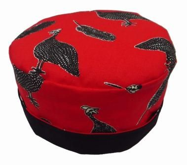 A fun handmade pill box hat in a cotton fabric depicting an iconic African bushveld bird in a soft fabric without padding on the crown. Fully reversible and ideal for travelling