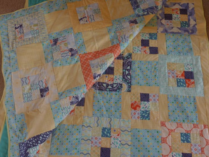 A pair of cot quilts for twins, using a pattern from 'Two From One Jelly Roll Quilts'.