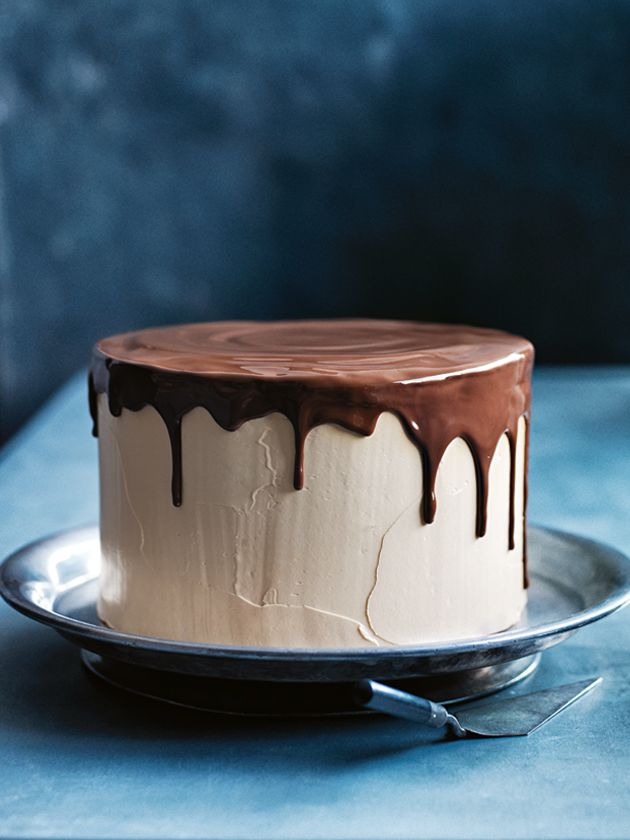 caramel butter cream layer cake with drippy chocolate glaze