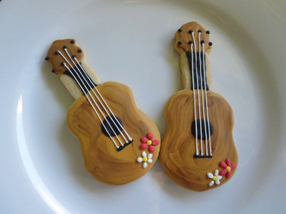 Ukulele Hawaiian Sugar Cookies. You can almost hear the sounds of the islands with these 12, made in Hawaii, ukulele sugar cookies. Each cookie arrives individually sealed in a cellophane bag to remain fresh and make them perfect for party favors or gift giving. Made with only the best ingredients, real butter and vanilla. Made on the Big Island of Hawaii.  *Please contact me before ordering to ensure that they may be made and delivered for your desired date.