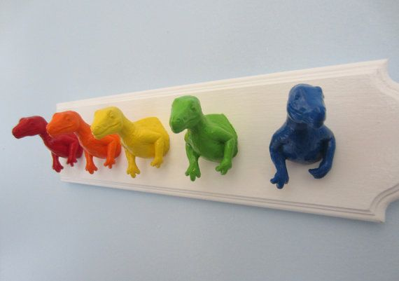 Upcycled Toy Wall Peg Rack with Rainbow Dinosaur by fbstudiovt Susie's note to self: How about train fronts on a strip of rail road track and maybe a train crossing X on the ends??