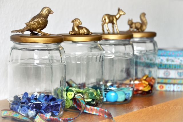 Reuse spaghetti jars. Glue dollar or thrift store plastic animals and spray paint. fun storage for small toys, kids art supplies, hair accessories and any number of other items.