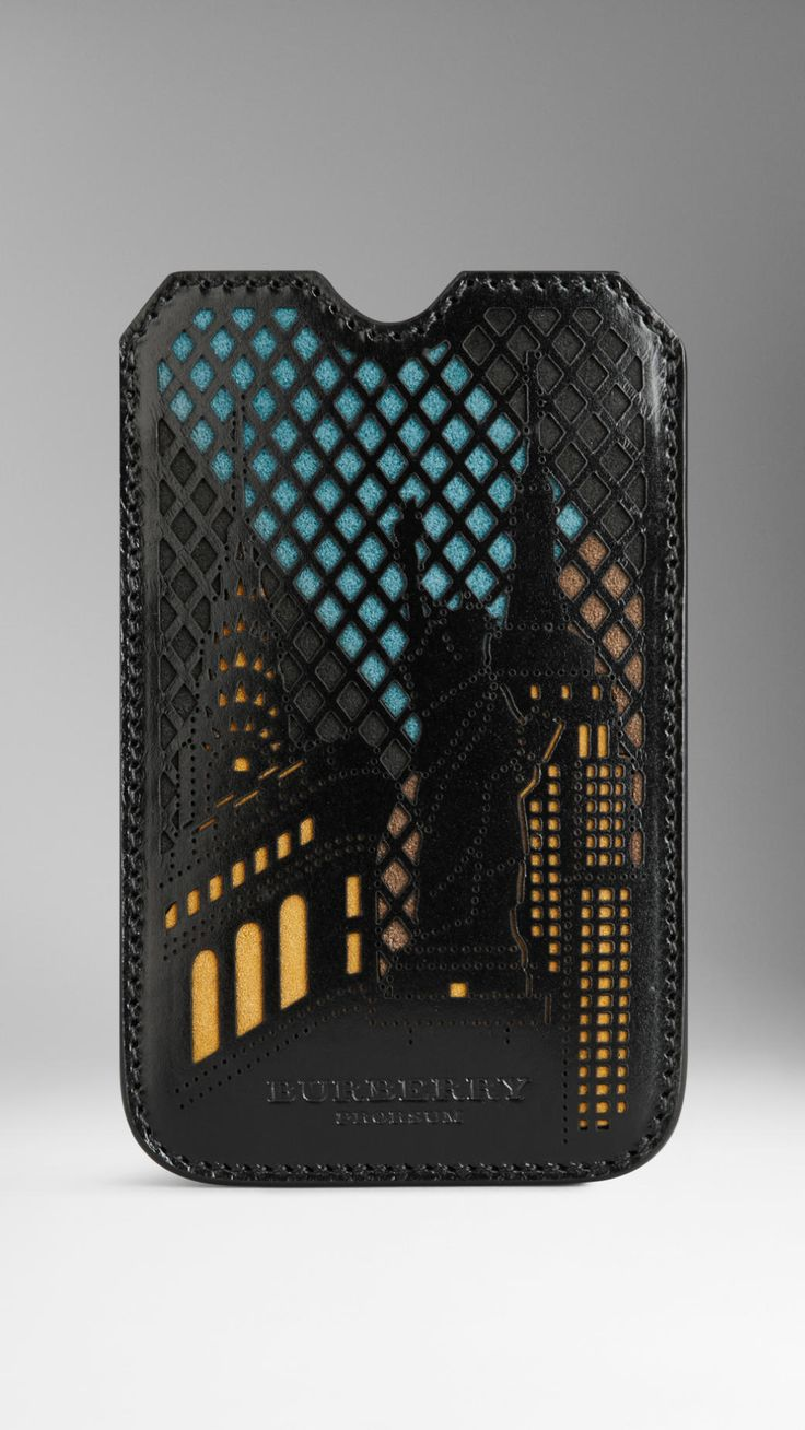 An iPhone case featuring a laser-cut New York city motif     Crafted from a patchwork of coloured suede overlaid with smooth bridle leather.