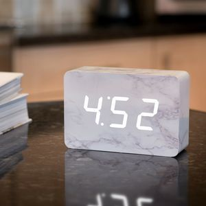 Ging Kou0027s Beautiful Portable Alarm Clock Has A Wood Body With A Marble  Finish. Its White LED Digits Appear When You Snap Your Fingers, Clap Your  Hands, Tap