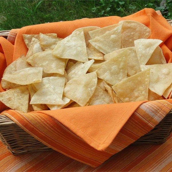 """Corn Tortilla Chips   """"Here's a simple recipe for making corn tortilla chips spiced only with salt. The chips may alternately be prepared by baking the tortilla wedges in a 350 degrees F (175 degrees C) oven for 5 minutes, or until crisp."""""""