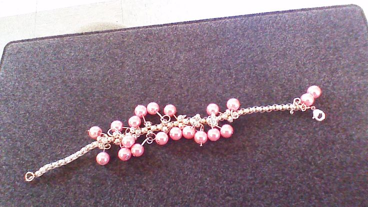This is a pink glass bead woven bracelet