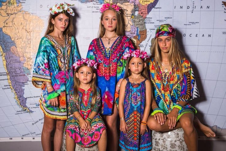Ruby Yaya | Kids Wear. Fashion for the boho & stylish kids. Colourful, fun & comfortable dresses and Blouses. Girls in boho colourful ruby yaya dresses with map on the background.
