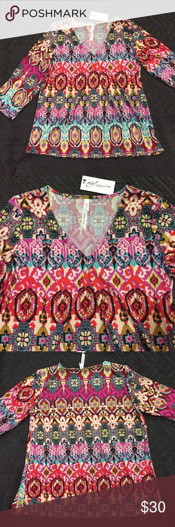 NET Pretty XL 3/4 sleeve top by NY Collection Love this print! NWT 3/4 sleeve top. Measures 19 1/2 inches pit to pit and 24 inches top to bottom. 96% polyester/4% rayon NY Collection Tops