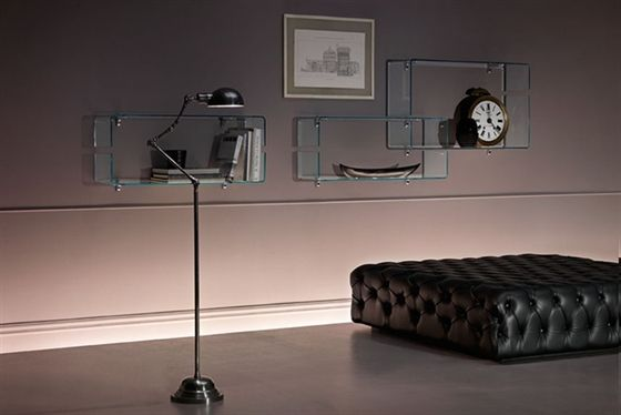 'Babila' Shelf in 10 mm-thick curved glass. Also available in extra-light glass. Brackets in chromed metal.