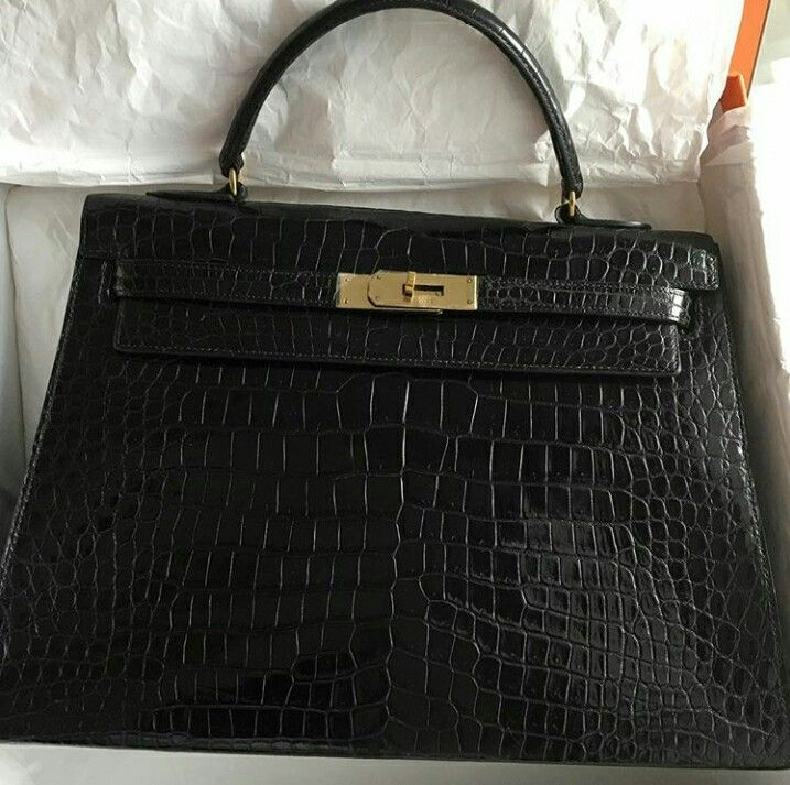 Model: Hermes Kelly 32  Condition: Preowned   Stamp: R for 1962  Color: Black   Leather: Porosus Crocodile   Comes with: Strap, clochette, lock, keys, dustbag, Hermes service receipt.  Cash promo: S$24xxx  SMS/Whatsapp: (65) 9.8.3.4.4.2.2.9  Email: sales at BJLuxury dot com ✅Authenticity Guaranteed.  ✅Credit card & Installments Available.   ✅Registered Company SINCE 2007. Not affiliated with brands we sell. All trademarks remain sole property of the brands.