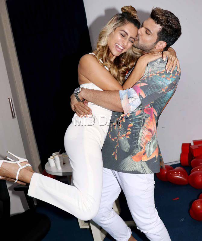 Karan Kundra and Anusha Dandekar indulging in some lovey-dovey moments at the promotional event for 'MTV Love School 2'. #Bollywood #Fashion #Style #Beauty #Hot #Sexy