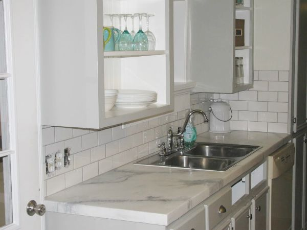 Concrete countertop made to look like marble - incredible.