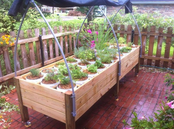 A automatically watered sub-irrigation (SIPs) raised bed designed by Michael Arceneaux, USA. He is using a three pipe system installed at the bottom of the bed along with a mini float valve that controls the watering of the 5 gallon planters. To see his complete set-up follow the link below:  https://www.facebook.com/mjarx/media_set?set=a.10201465592420862.1073741827.1207243853&type=1&l=65f1baeaec