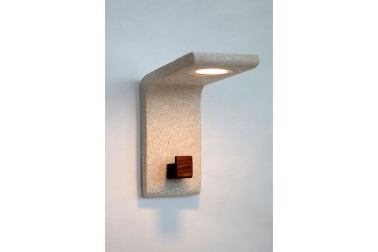 Extrude wall lamp with walnut hook in natural white concrete.