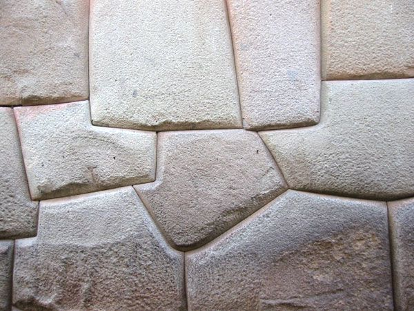 The Inca civilization is credited with the magnificent monumental architecture that adorns its sacred sites; polygonal stone blocks are fitted so perfectly that not even a razor blade can be inserted between them