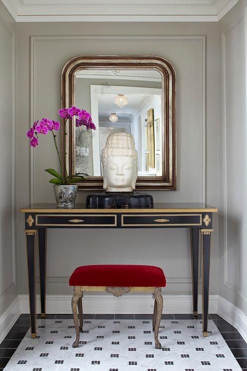 Chic Foyer Features A Red Velvet French Stool Tucked Under A Gold And Black  French Console