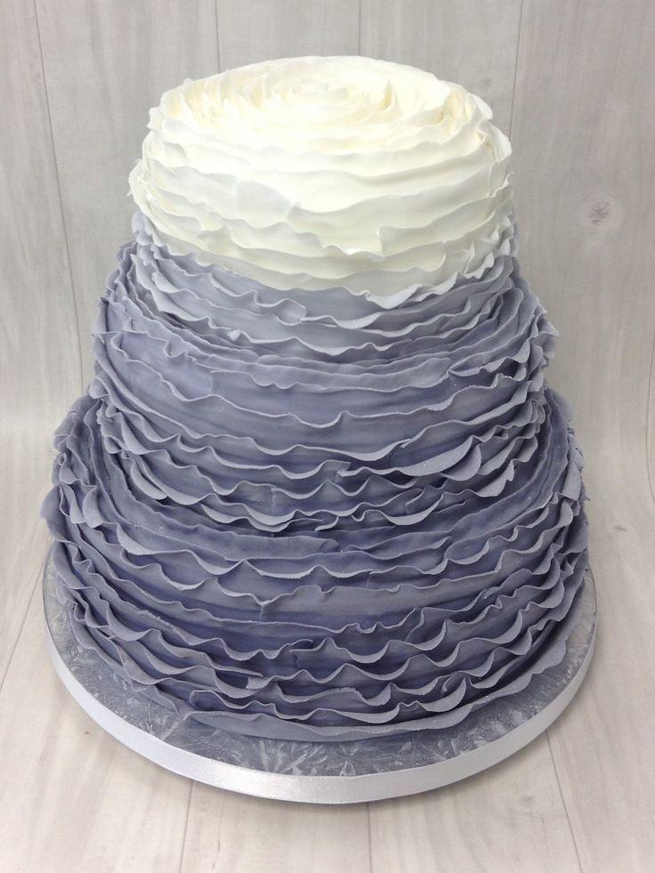 upwards ruffled ombre grey wedding cake with ruffled top.