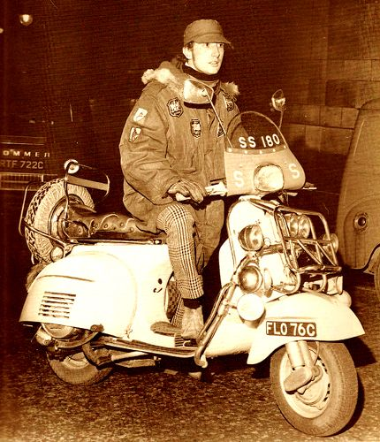 Pete Quaife of The Kinks and his Vespa SS 180 scooter in the mid-1960's.