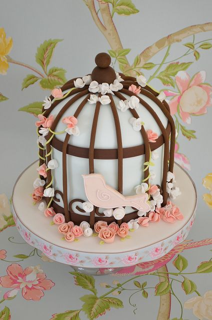 Anniversary bird cage cake .This is inspired by Zoe Clark, a white chocolate and raspberry layer cake