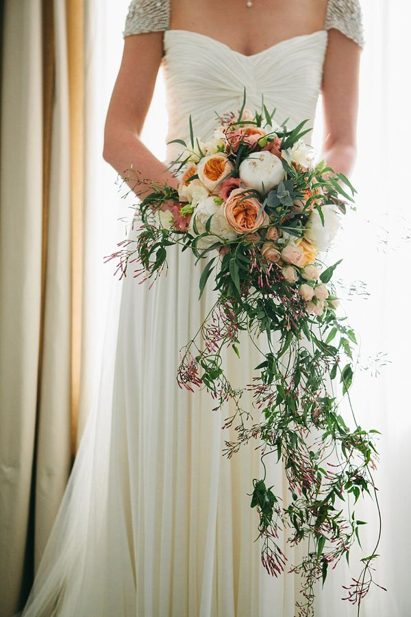 Incredibly beautiful tumbling peach wedding bouquet, from 'Two Wedding Dresses And a Sweet Knitted Cape For a Swallows And Amazons Inspired English Country Wedding' on www.lovemydress.net.  Photography http://www.saccophotography.co.uk/