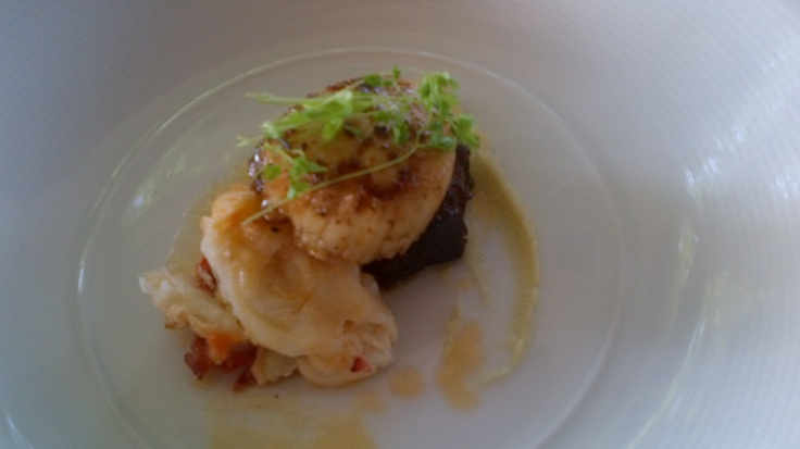 a triad of Seared Pork Belly, Scallop and a Poached Lobster with Vanilla Parsnip Puree – what a symphony of tastes when paired with a 2009 St. Urban Riesling!