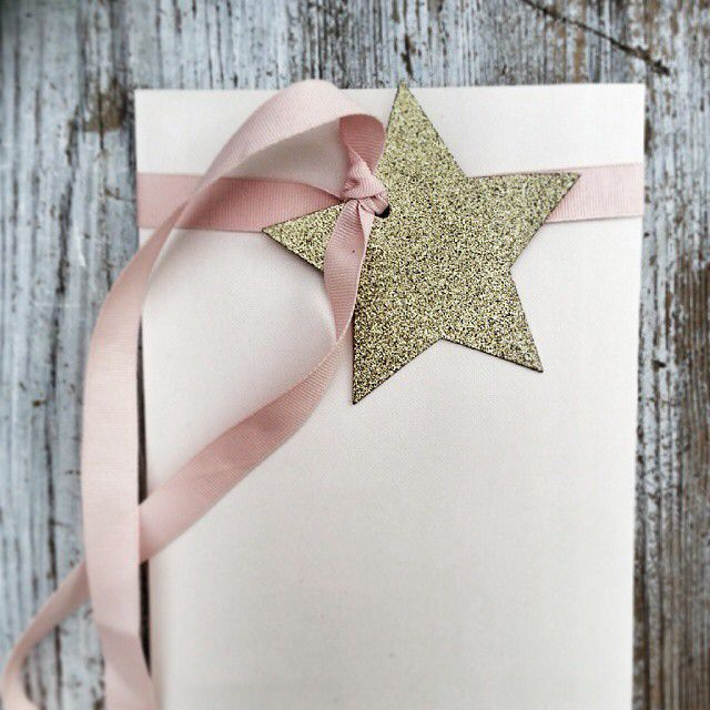 Gift wrapped simply with a satin bow and a glitter star tag