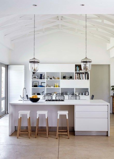The family spend time in the white-on-white kitchen, which is in the original part of the home | Home Beautiful Magazine Australia