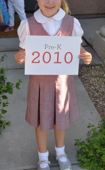 I like the idea of making a sign that shows the Year, grade, and maybe even the teacher's name for each child.