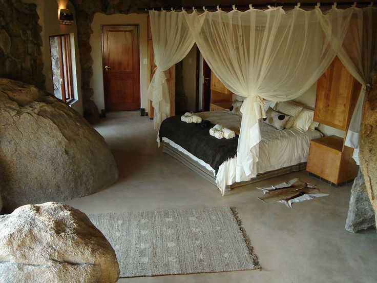 Bed surrounded by Rocks