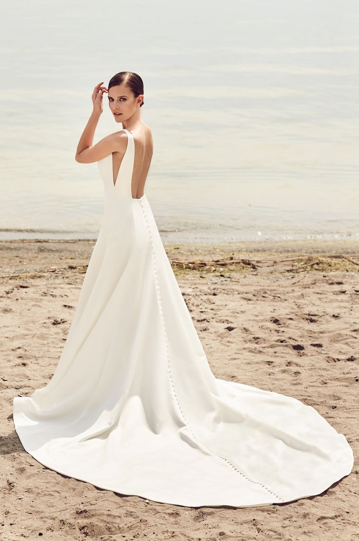 View Sleek Modern Wedding Dress - Style #2115 from Mikaella Bridal. Satin gown with bateau neckline and V-shaped Nude Tulle inserts at side seam on bodice.