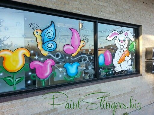 Easter window painting bunny butterfly tulips chick and eggs www.facebook.com/paintslingers.biz.  www.PaintSlingers.biz