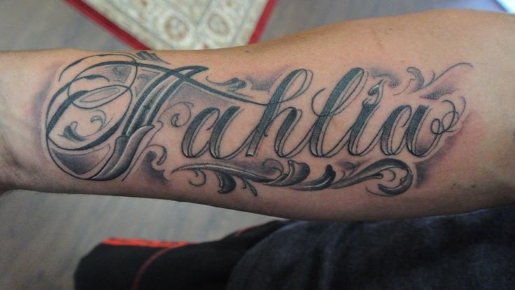 Tattoo by Lou Shaw - Four Aces Tattoo, Aldinga Beach, South Australia - 8556 5467 Custom drawn script on forearm 'Tahlia' Tattoo lettering, tattoo script, custom tattoo, arm tattoo, name tattoo, black and grey tattoo