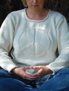 Free Knitting Pattern for Imagine Sweater - This long-sleeved pullover features a peace sign motif on a sweater with a modified drop shoulder and arounded neckline with reverse-stockinette rolled edges that also appear at hem and cuffs. Designed by A. Karen Alfke. SizesXS – XXXL
