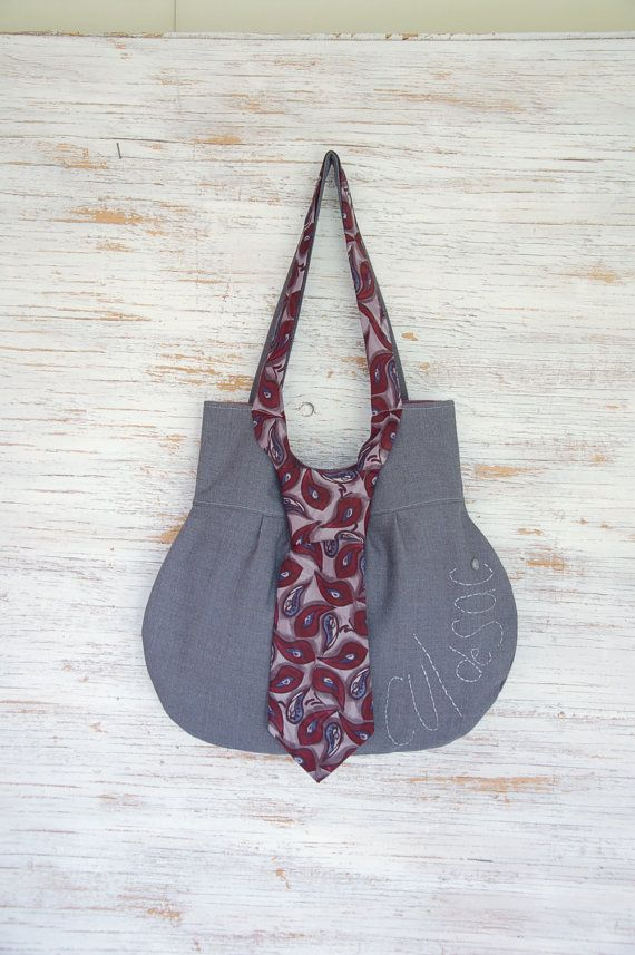 Eco-friendly necktie handbag made from upcycled fabrics! Go out and look sophisticated with a convenient shoulder bag!    This crisp looking and