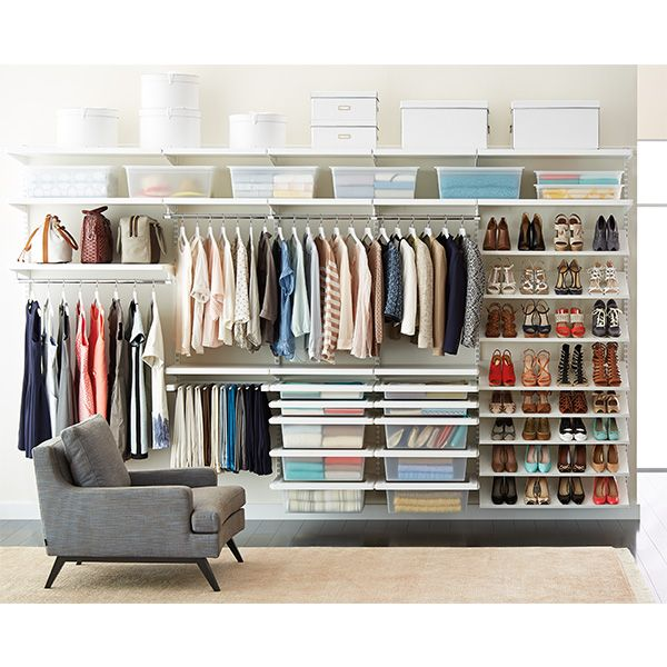 Transform a wall into a closet with elfa décor! You'll love the way the white finish on our elfa décor elements brightens your space with the elegance of real wood. This closet features a wealth of room for long- and short-hanging garments, shelf space for accessories, smooth-gliding solid drawers plus angled shelves for storing shoes.