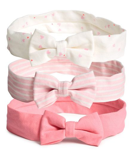 Check this out! Jersey headbands with an attached bow at front and elastication at back. - Visit hm.com to see more.