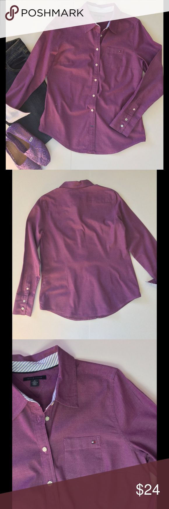 """🆕 Listing Hilfiger Button Up Shirt This must have Tommy Hilfier shirt is a beautiful shade of purple with blue striped cuffs and neckline. Excellent pre-owned condition. No damage. 100% cotton. Machine wash. 38"""" bust 37"""" waist 24"""" length from shoulder to shortest part of shirttail. Pictured shoes and jeans are listed separately  🎀Bundle discount  ⭐️5 star rated Suggested User 🚭Smoke free home 🚫No trades please  😍 Thank you for shopping with me. Please ask all questions before purchase…"""