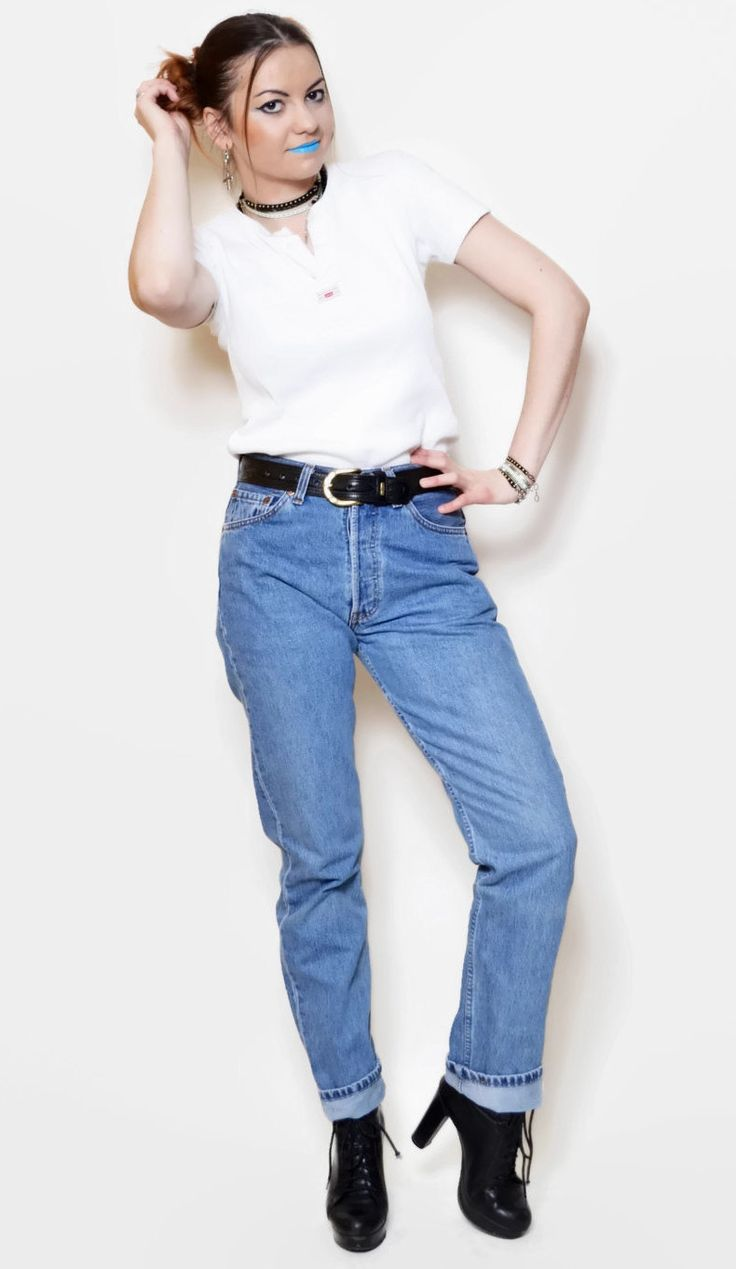 Vintage high waisted jeans by Levis. Model: 501. The model on the pictures is size S/36 and 165 cm height. Please check measurements with your own to avoid problems with the size. Make sure you double the measurements where shown (*2):  Label size: W29 L/32 Total lenght: 107 cm / 42.25 inches Waist: 34.5 cm *2 / 13.5 inches *2 Hips: 48 cm *2 / 19 inches *2 Thigh: 26.5 cm / 10.5 inches *2 Lenght from the crotch to bottom: 77.5 cm / 30.5 inches Bottom width: 1...
