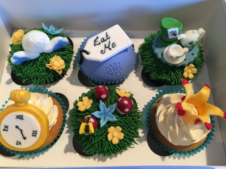 My 'Curious Collection' - Alice in Wonderland inspired cupcakes with hand-made toppers - white rabbit bottom, 'Eat Me' label, Mad Hatter's tea set and hat, gold watch, enchanted garden and Queen of Hearts gold crown - all hand-made and painted and all 100% edible