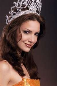 Denise Marie Quiñones August (born September 9, 1980) is a Puerto Rican actress and beauty pageant titleholder who was the fourth woman from her country to win the Miss Universe contest. Prior to winning the Miss Universe pageant, she represented her hometown of Lares in the Miss Puerto Rico Universe 2001 pageant.