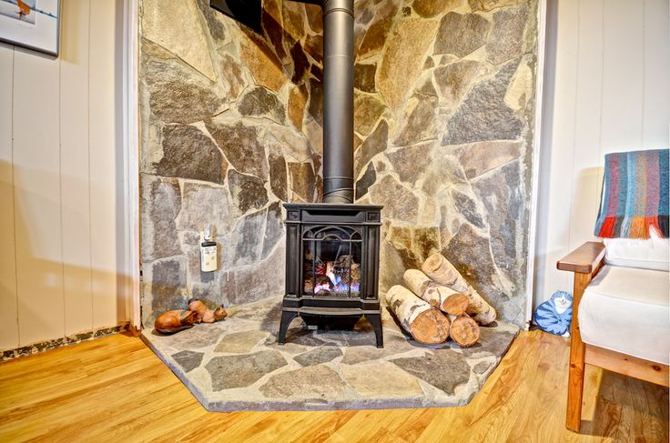 I just love this great faux-wood-stove gas fireplace with the stone surround!  #Orangeville #OrangevilleOntario #OrangevilleRealEstate