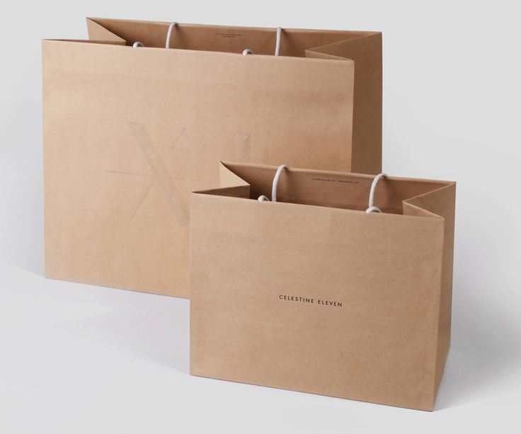 Logo and unbleached paper carrier bags designed by Construct for luxury fashion and homeware store Celestine Eleven
