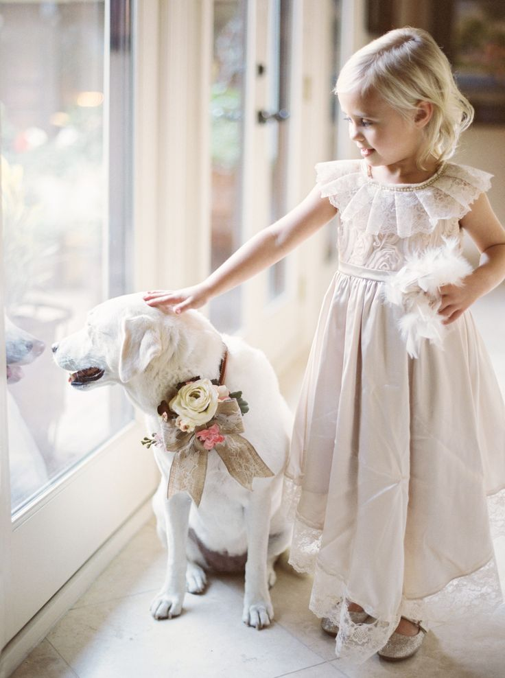 Oh my goodness! Flower Girl & Dog -- What a portrait! TaylorLordPhotography.com -- See more of the wedding here: http://www.StyleMePretty.com/2014/05/27/romantic-houston-backyard-wedding/