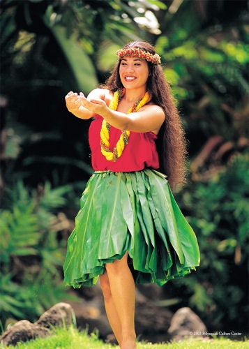 Hula kahiko wahine or female ancient hula performed in the Hawaiian Village at the Polynesian Cultural Center in Laie, Oahu, Hawaii