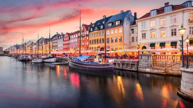 COPENHAGEN, DENMARK  (2017: 1 USD = 7 DKK) -   With an exchange rate that favors the U.S. dollar, Copenhagen is more accessible than ever. A cozy city, Copenhagen lacks a towering skyline. Instead, visitors can stroll quiet streets lined with shops and bakeries. It's also one of the more bike-friendly cities in Europe, so consider ditching the rental car in favor of a bicycle.