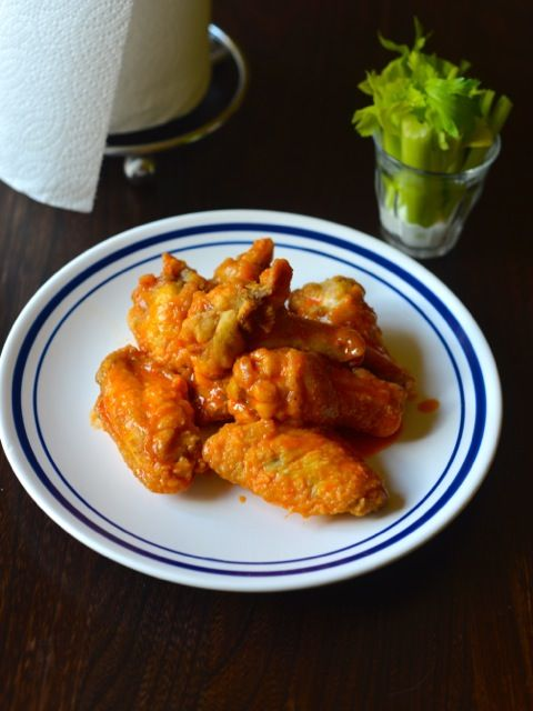 Wings and Things Garlic Buffalo Wings. They have a bit of spice, and a nice garlic flavor kicks in, and suddenly you are grabbing for the next wing. #copykat from CopyKat.com.