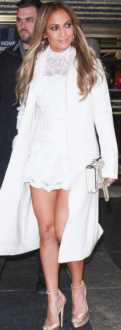 Who made  Jennifer Lopez's white lace dress and crystal handbag?