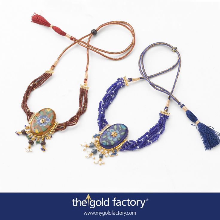Genuine Jaipur ceramics made exclusively for us by expert craftsmen to our design and specification. Here you see a pair of chokers in classic colour combinations, framed in gold and dotted in the centre with a gold motif. They're strung with Shantiniketani glass beads and have tassels for adjustment.  All in 22K hallmarked yellow gold.